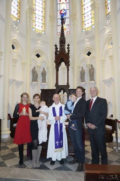Baby Caitlin with Mum and Dad, James and Julia, godparents and Fr Nigel